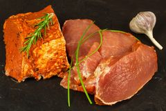 Marinated pork chop. Fresh sliced pork. Sale of meat. Preparation for grilling. Royalty Free Stock Photo