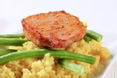 Marinated pork with couscous and green beans Royalty Free Stock Photo