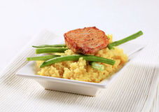 Marinated pork with couscous and green beans Stock Photos