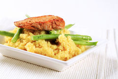Marinated pork with couscous and green beans Royalty Free Stock Photos