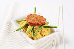 Marinated pork with couscous and green beans Stock Photo