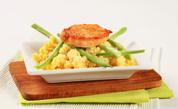 Marinated pork with couscous and green beans Stock Image