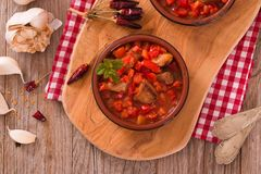 Marinated pork loin in tomato sauce. Marinated pork loin in tomato sauce on cutting board royalty free stock photos