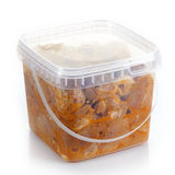 Marinated pork meat pieces in a plastic box Stock Images