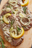 Marinated pork with onion, lemon and herb Stock Photo