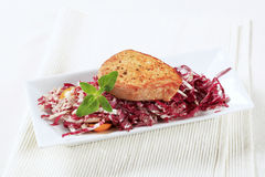 Marinated pork and red cabbage. Marinated pork and fresh red cabbage salad royalty free stock photo
