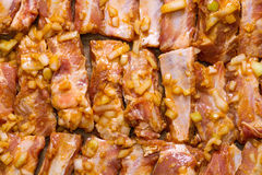 Marinated pork ribs ready for roasting. Royalty Free Stock Image