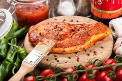 Marinated pork steak on cutting board Royalty Free Stock Photos