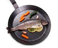 Marinated Rainbow trout with lemon on frying pan. Top view royalty free stock images