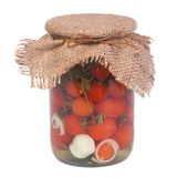 Marinated ripe tomatoes in a glass jar isolated Royalty Free Stock Photography