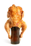 Marinated and roasted chicken on a beer bottle Stock Images
