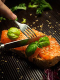 Marinated salmon with basil and sesame seeds on slice of bread Royalty Free Stock Photography