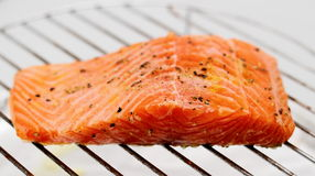 Marinated salmon fillet on grill Stock Photos