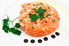 Marinated salmon fillet on plate Royalty Free Stock Photography