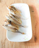 Marinated salted fish in a plate on wooden background Stock Photo