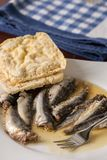 Marinated sardines in the oil served with corn bread Stock Photo