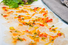 Marinated sea bass filet with ratatouille dressing. Close up Stock Image