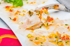 Marinated sea bass filet with ratatouille dressing Royalty Free Stock Images