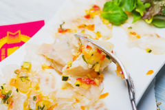 Marinated sea bass filet with ratatouille dressing Royalty Free Stock Photo