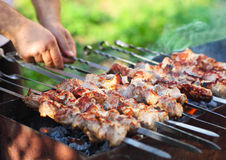 Marinated shashlik, lamb meat grilling on metal skewer, close up Stock Photo