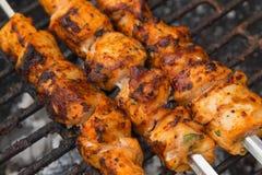 Marinated shashlik preparing on barbecue grill Royalty Free Stock Images