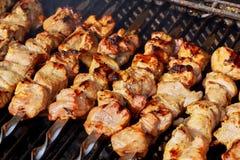 Marinated shashlik preparing on a barbecue grill over charcoal. Shashlik or Shish kebab. Popular in Eastern Europe. Shashlyk skewered meat was originally made Stock Image