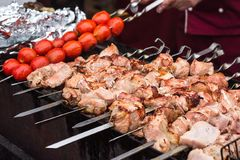 Marinated shashlik preparing on a barbecue grill over charcoal. Shashlik or Shish kebab popular in Eastern Europe. Shashlyk skewe. Red meat was originally made Royalty Free Stock Photography