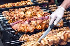 Marinated shashlik preparing on a barbecue grill over charcoal. Shashlik or Shish kebab popular in Eastern Europe. Shashlyk skewe. Red meat was originally made Royalty Free Stock Photo