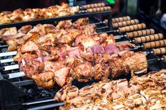 Marinated shashlik preparing on a barbecue grill over charcoal. Shashlik or Shish kebab popular in Eastern Europe. Shashlyk skewe. Red meat was originally made Royalty Free Stock Image