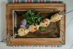 Marinated shashlik or Shish kebab preparing on a barbecue grill over charcoal. Marinated shashlik preparing on a barbecue grill over charcoal. Shashlik or Shish Royalty Free Stock Photo
