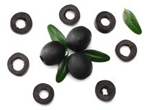 Marinated slices black olives isolated on white background. top view stock photo
