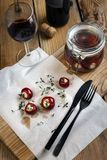 Marinated small red peppers stuffed goat cheese royalty free stock image