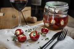 Marinated small red peppers stuffed goat cheese stock image