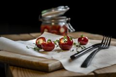 Marinated small red peppers stuffed goat cheese royalty free stock photography