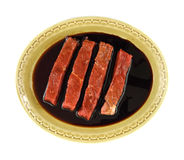 Marinated steak strips in old dish Royalty Free Stock Photo