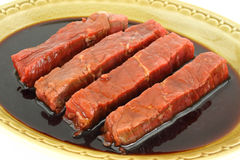 Marinated steak strips in old dish Royalty Free Stock Photos