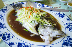 Marinated steamed fish with onion and ginger Stock Photo