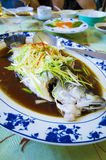 Marinated steamed fish with onion and ginger Stock Photography
