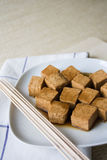 Marinated tofu with skewers Stock Images