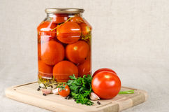 Marinated tomatoes. In the bank with spices Stock Image