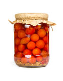Marinated tomatoes in glass jar Royalty Free Stock Photo