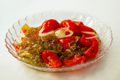 Marinated tomatoes on a plate of home cooking Stock Photo