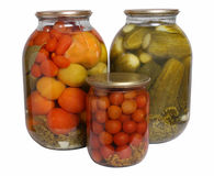 Marinated Vegetables. In glass banks on a white background Royalty Free Stock Photography