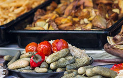 Marinated vegetables and baking tray with fried potatoes Stock Photos