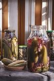Marinated vegetables in jars. Pickled cucumbers with red currants. Ecological product Stock Photo