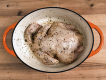 Marinated whole chicken Stock Image