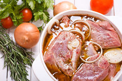 Marinating meat. With spices and onoin royalty free stock photo