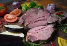 Marinating meat and fresh vegetables on wooden table stock photography