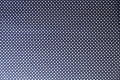 Marinblå textil med vita prickar arkivbild