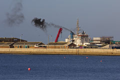 Marine and air pollution. A large seagoing vessel creating black smoke Royalty Free Stock Image